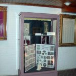 Historic General Dodge House Mourning Exhibit March - November Display cases in the basement showing different types of mediums people would use in mouring including calling cards, hair ornaments and clothing