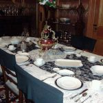 Historic General Dodge House Mourning Exhibit March - November Dining Room set with black dishes to demonstrate the house in mourning