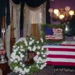 Historic General Dodge House Mourning Exhibit March - November Casket displayed in Front Parlor for viewing of body. The body could be in repose for up to three days in the home.
