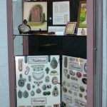 Historic General Dodge House Mourning Exhibit March - November Display cases in the basment showing different types of mediums people would use in mouring including calling cards, hair ornaments and clothing